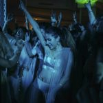 A Parsi girl dancing during a party for a wedding anniversary