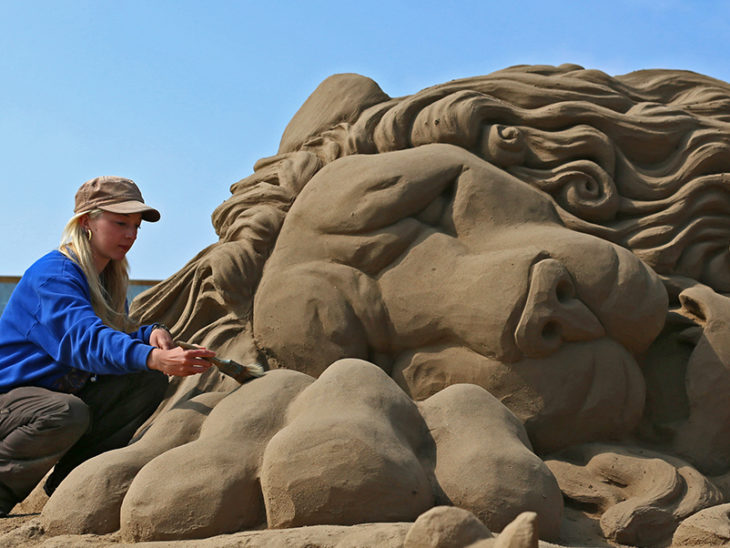 Sculptors Place The Finishing Touches To Their Once Upon a Time Sand Sculptures